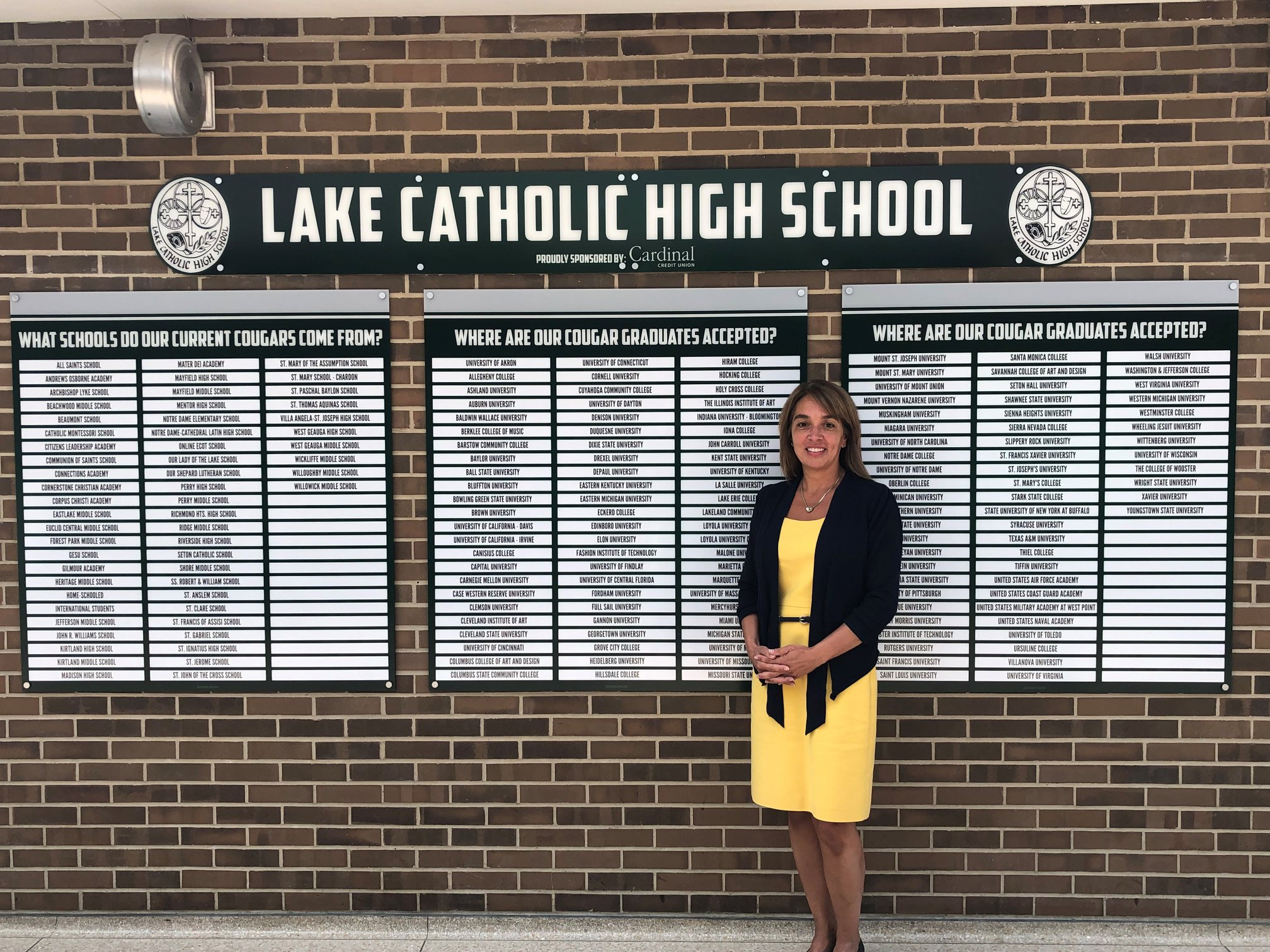 Christine Blake at Lake Catholic in front of Leaderboards